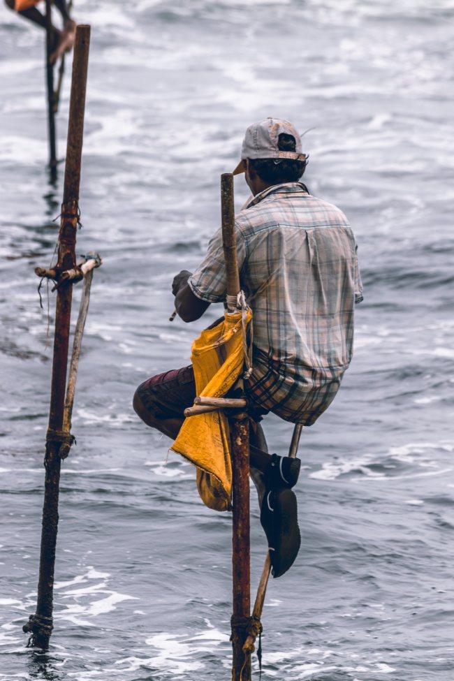 Pescadores con su bolsa de presas